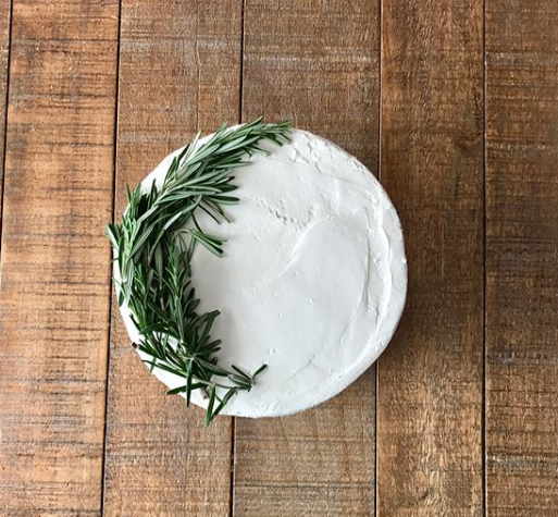 Cake with rosemary accent designs